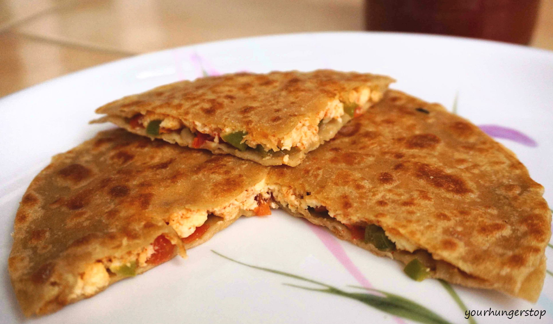 ... garlic day this peppy paneer paratha brings together paneer tomato and